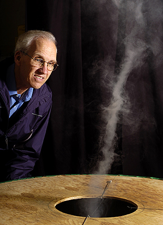 """Inventor Louis Michaud watches as a tornado-like vortex rises from a small """"vortex engine"""" in the garage of his Sarnia home in May. Michaud believes a full-scale vortex engine could be used to produce clean energy for 200,000 homes."""
